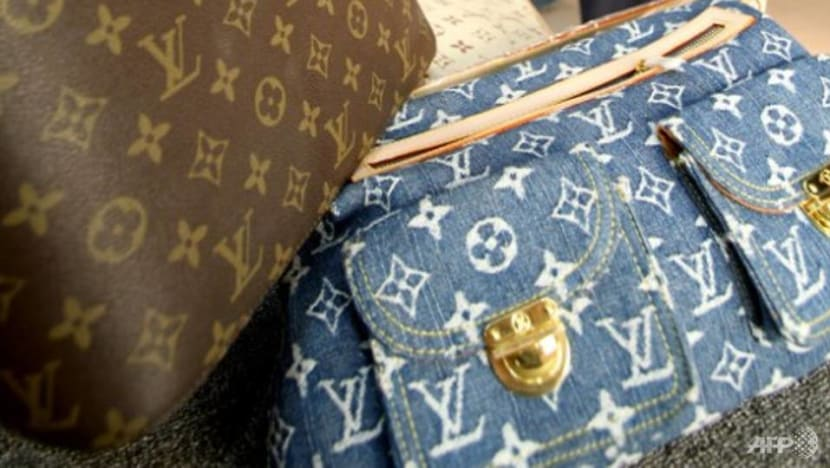 Commentary: More buying counterfeit goods and knock-offs - it's costing billions and more