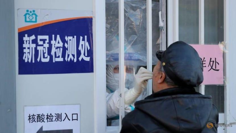 'No need to panic,' China official says of coronavirus variants
