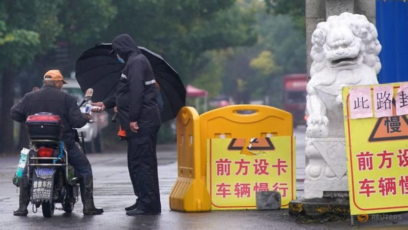 China reports 12 new COVID-19 cases
