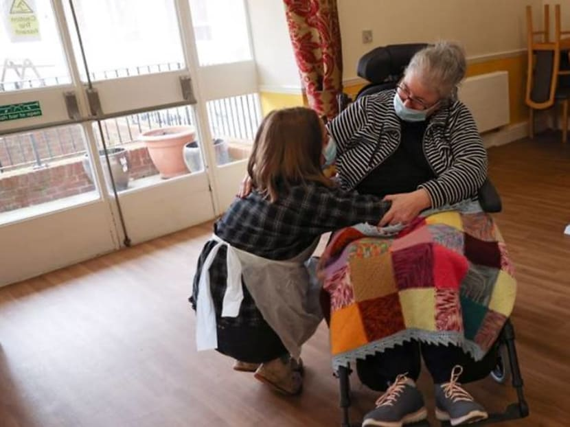 Joy as Britain's care home residents share first hugs with relatives since March