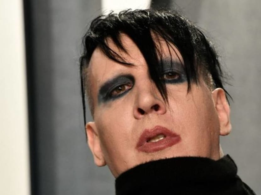 Arrest warrant issued for rock singer Marilyn Manson on assault charges