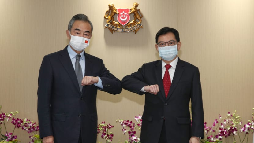 China's Foreign Minister Wang Yi meets Singapore DPM Heng, Minister Balakrishnan on first day of visit