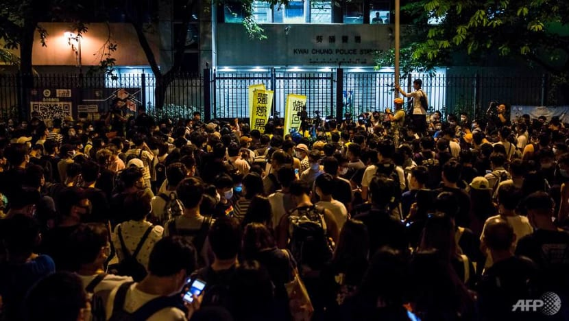 Clashes between officers and protesters outside Hong Kong police station
