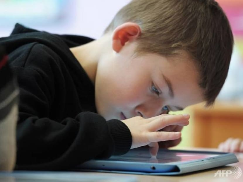 Junk digital diet: Children drowning in visual equivalent of eating 'pizza and sweets'
