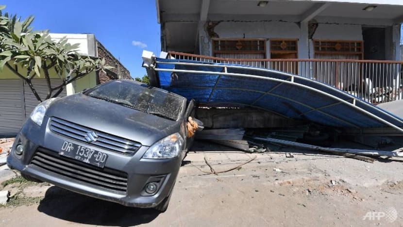 Woman rescued from rubble of deadly quake on Indonesia's Lombok