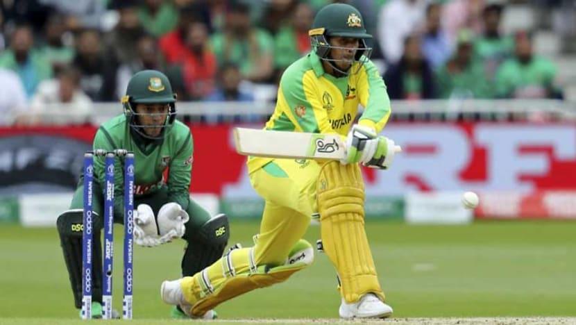 Cricket: Warner ton against Bangladesh sends Australia top of World Cup table
