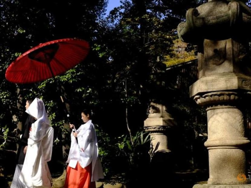 Something blue: Pandemic wedding plunge adds to Japan demographic woes