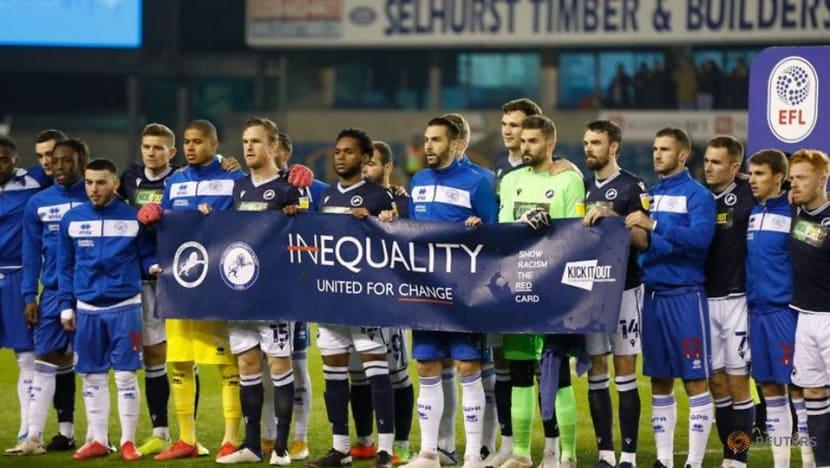 Football: Millwall fans applaud anti-racist banner