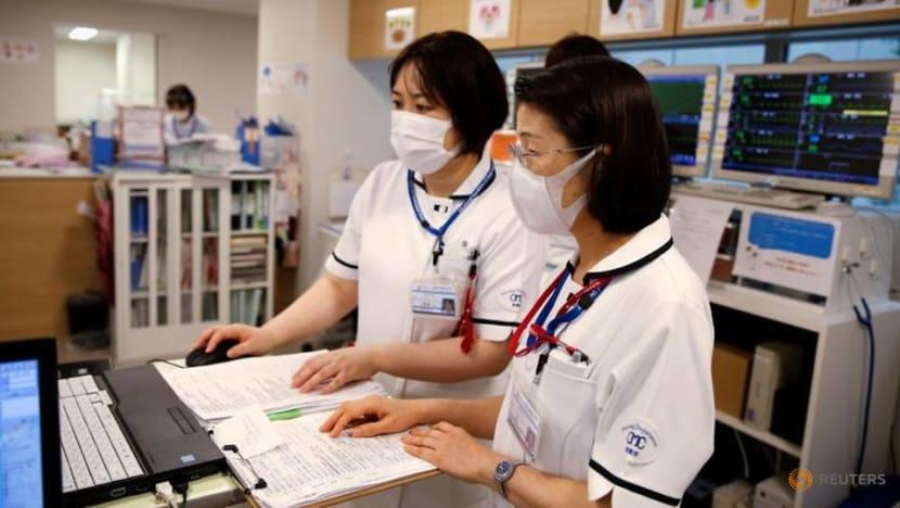 Japan's Osaka city crumples under COVID-19 onslaught