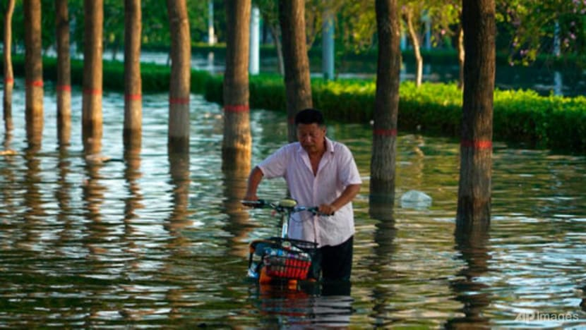 Death toll from flooding in China's Henan province jumps to 302