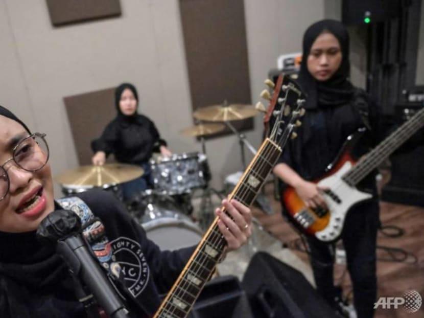 Indonesia's hijab-wearing headbangers VOB trade village life for metal heaven