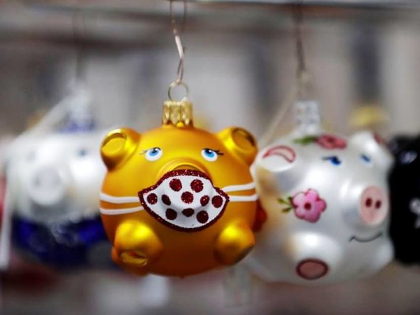 Czech golden pig ornaments wearing tiny masks are a hit for COVID Christmas