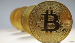 Bitcoin closes in on record high, day after US ETF debut