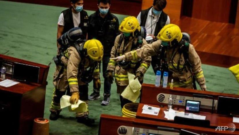 Protests disrupt debate as Hong Kong legislature starts voting on controversial China national anthem Bill