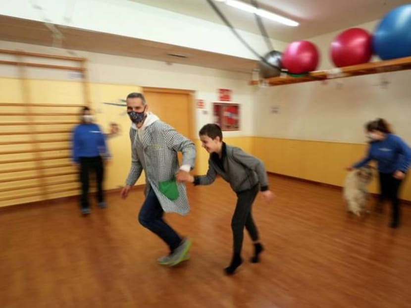 Wagging tails: therapy dog cheers Spanish special-needs kids during COVID