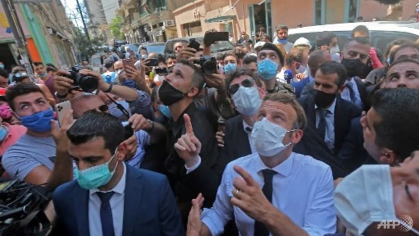 Angry crowds in Beirut urge French President Macron to help bring change after deadly blast