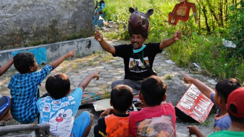 With stories and puppets, environmentalist battles to save Indonesia's mangroves