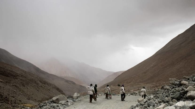 Indian workers toil at one of world's highest roads