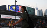 Malaysia reports lowest number of new COVID-19 cases since June as movement, travel restrictions eased