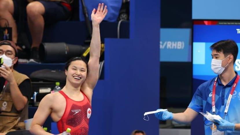 Swimming: Canada's MacNeil wins women's 100m butterfly gold at Tokyo Olympics