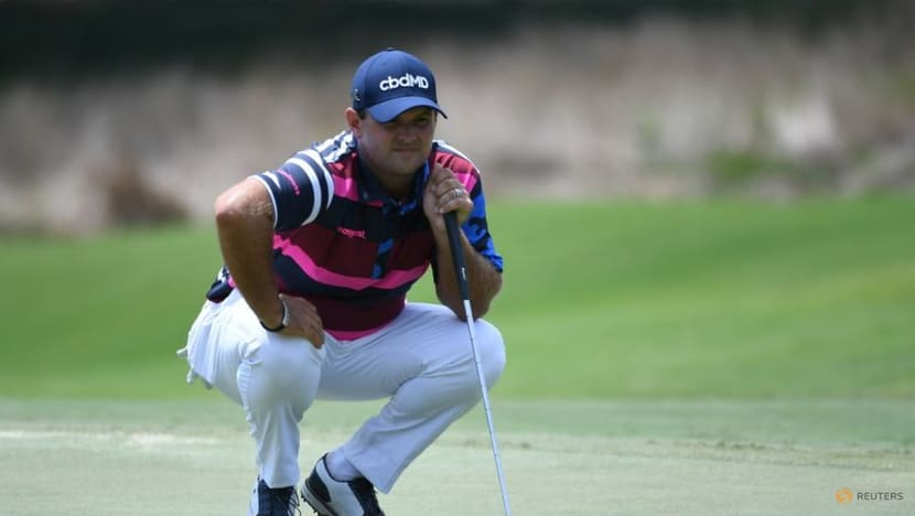Golf-Reed withdraws from playoffs opener, Ryder Cup hopes take hit
