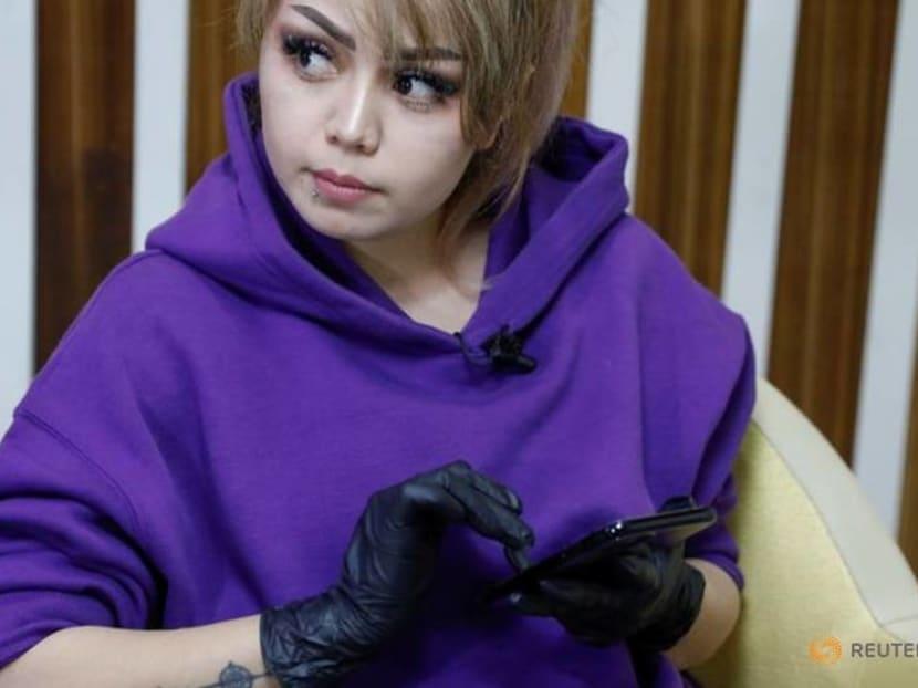 Afghan female artist breaks tattoo taboo in Kabul studio