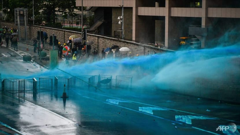 Hong Kong police fire tear gas, water cannon at protesters defying rally ban