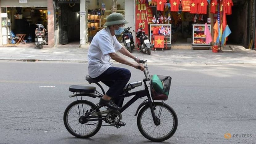 Vietnam expands movement curbs as COVID-19 cases hit record high