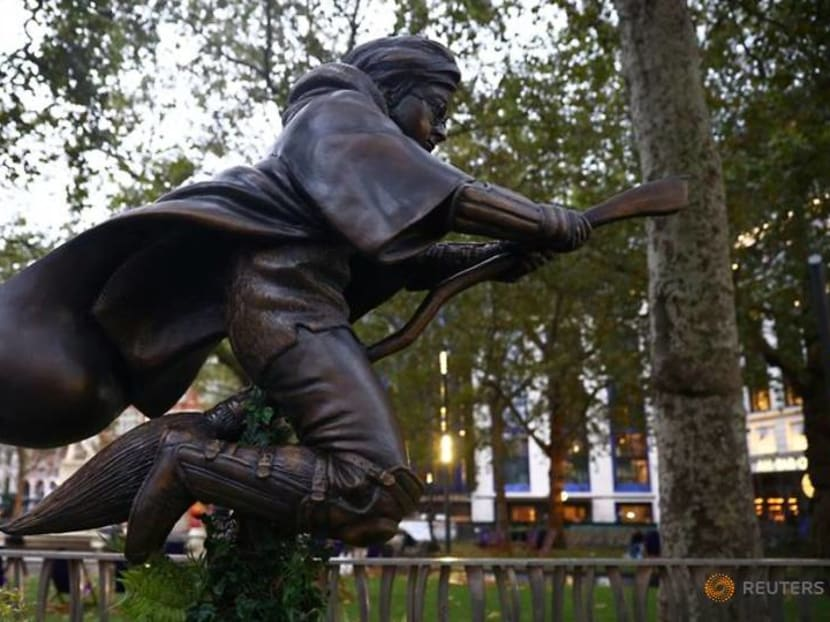 Statue of Harry Potter playing Quidditch up in London's Leicester Square