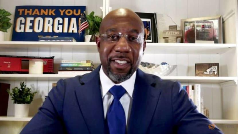 Democrat Warnock projected to have won Georgia Senate runoff