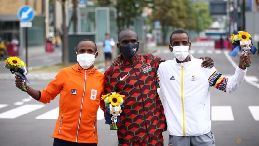 Olympics-Athletics-Friendship first as Nageeye waves Abdi over marathon finish