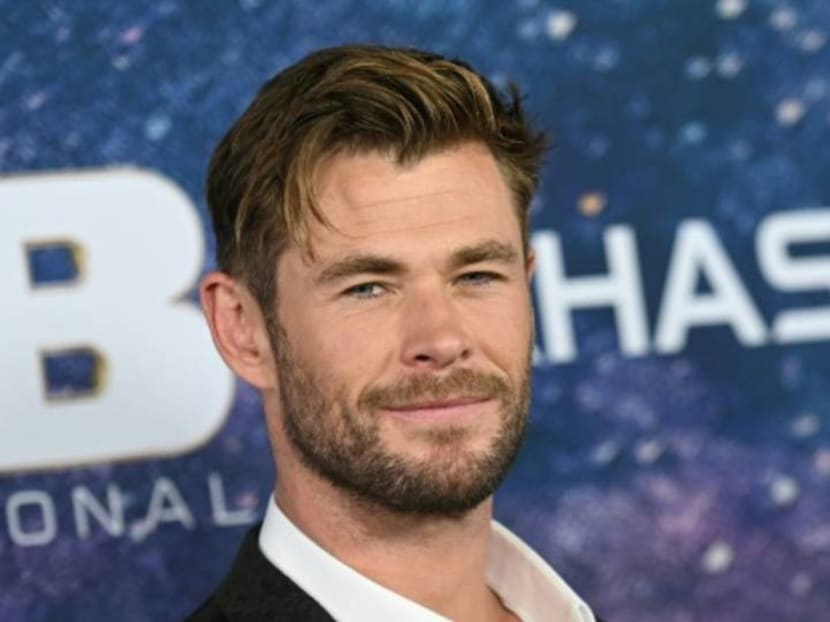 Chris Hemsworth celebrates 'national don't flex day' as Thor filming wraps