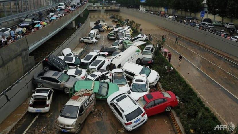 City in China's Henan province picks through debris after record rains kill 33