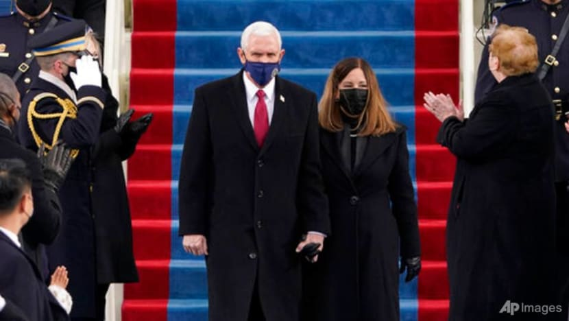 Trump's vice president Pence applauds successor at inauguration
