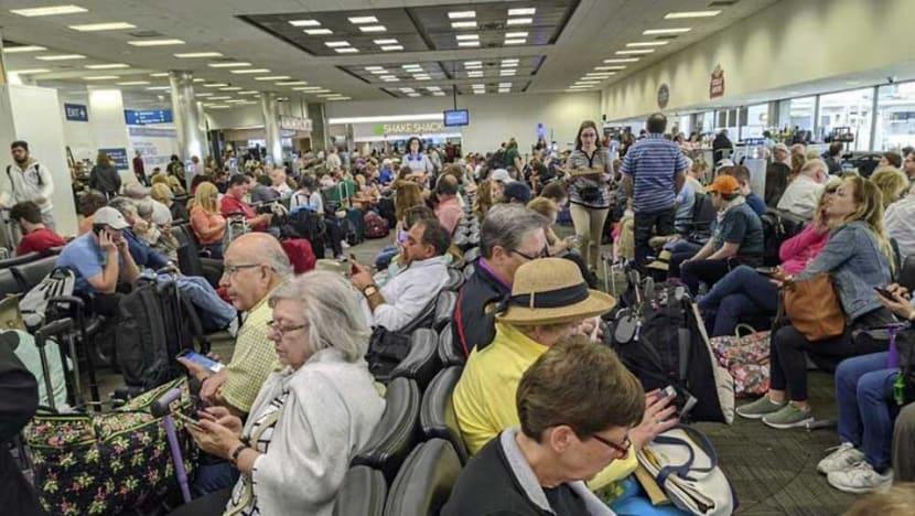 Chaos at US airports as COVID-19 medical screenings jam up returning Americans