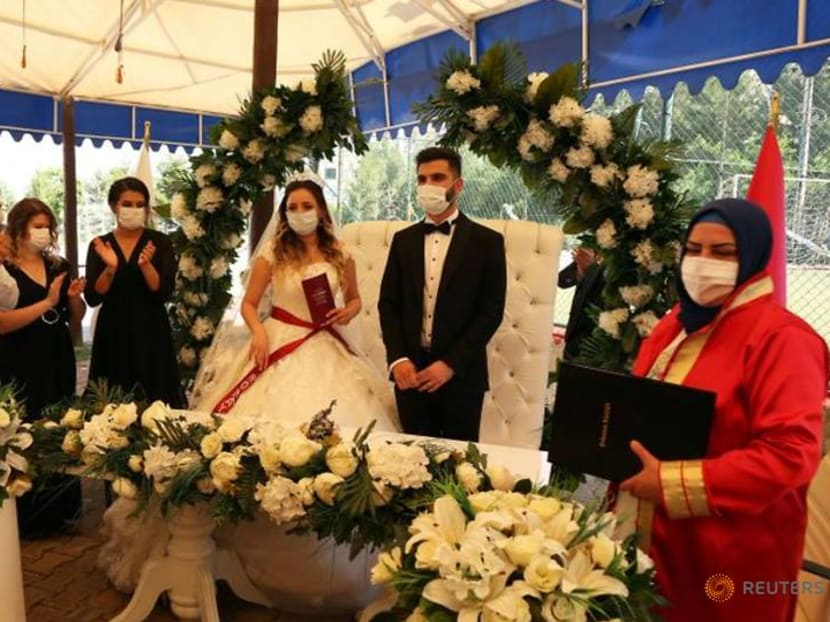 Turkey's wedding halls reopen with lace-trimmed masks and muted celebrations