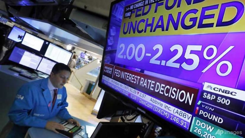 Wall Street ends mostly lower as Fed leaves rates unchanged