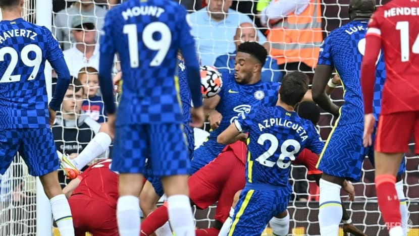 Football: Ten-man Chelsea hold out for 1-1 draw at Liverpool