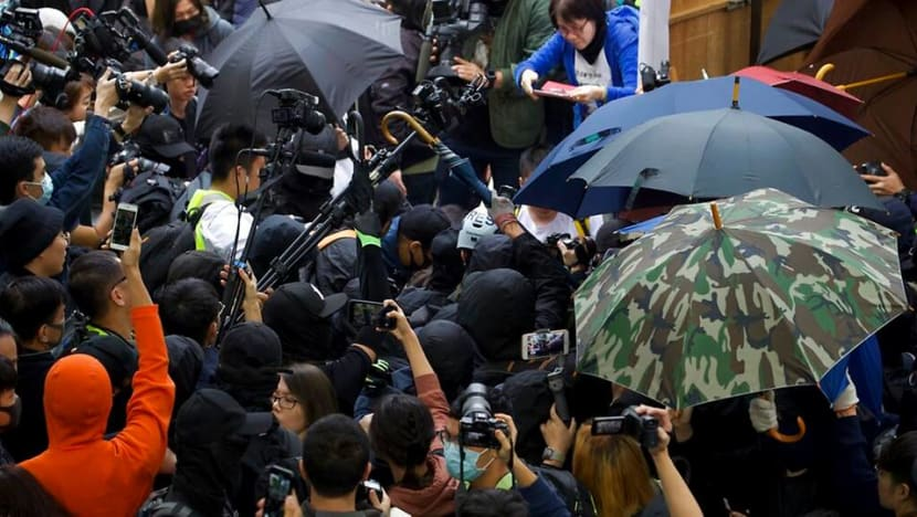 Officers beaten after police disband Hong Kong rally