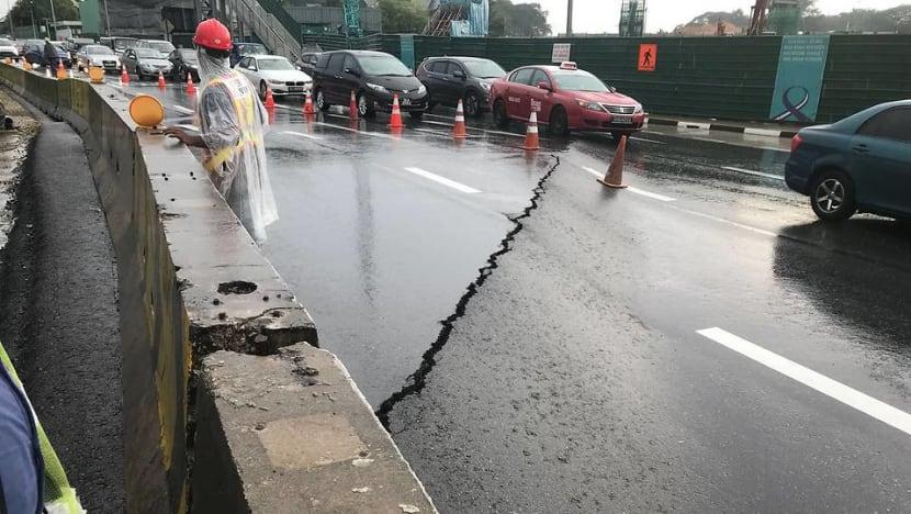 Cracks on Adam Road cause 'massive' traffic jams