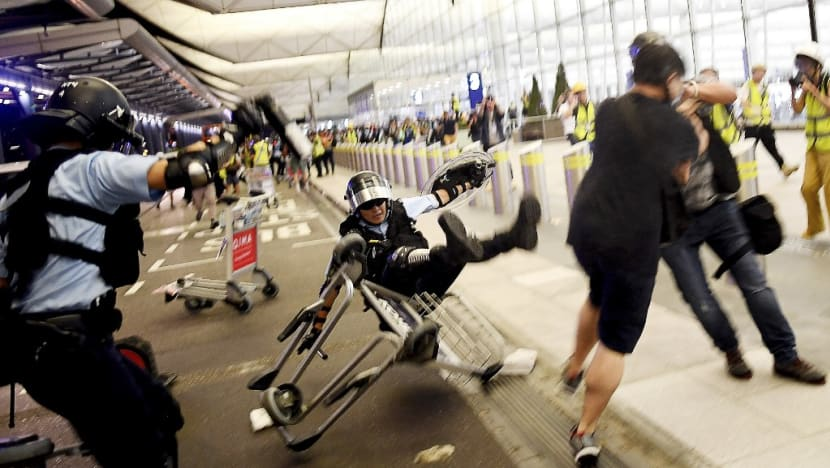 In photos: Hong Kong airport protests turn violent after standoff over suspected undercover officer