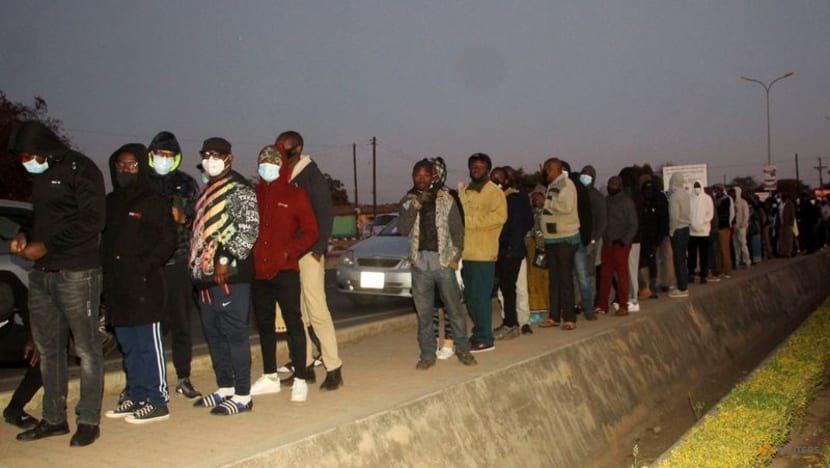 Zambians vote in tight presidential election, internet restricted