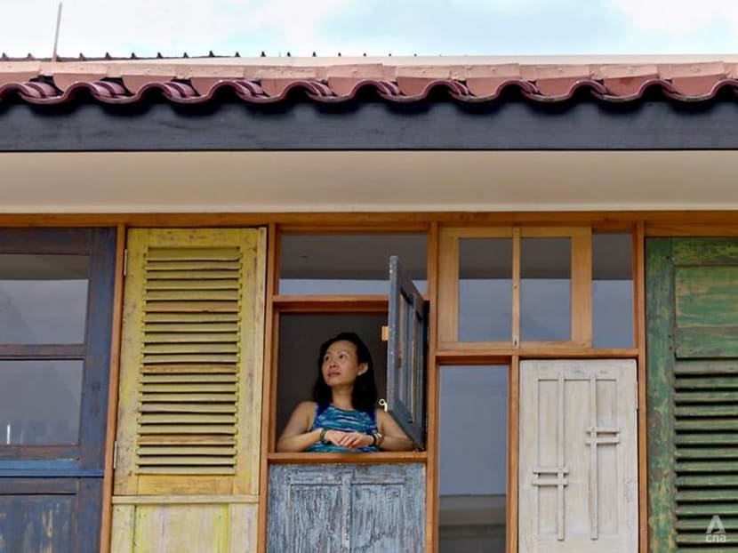 A terrace house in Singapore with upcycled Javanese windows and kampung vibes