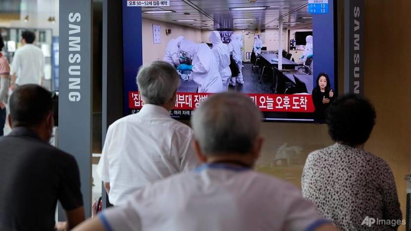 South Korea leaders apologise for navy ship COVID-19 outbreak amid vaccine furore