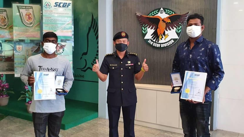 Migrant workers receive SCDF award for rescuing boy from ledge of Hougang flat