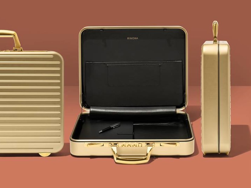 Elevate your business style with this classic Rimowa briefcase fashioned in gold