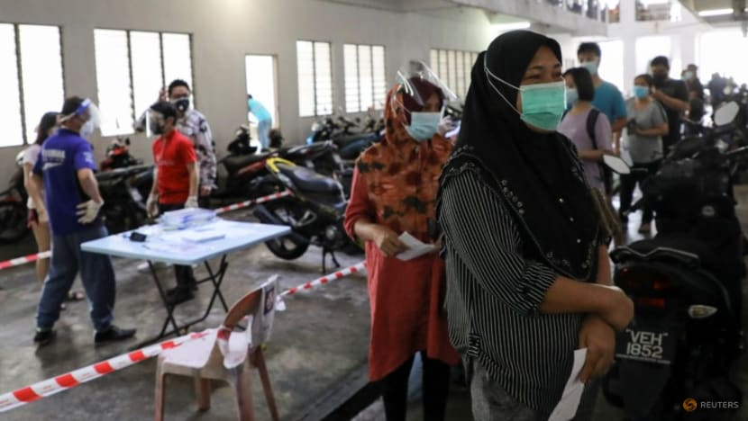 Malaysia reports record 21,668 new COVID-19 cases; pregnant women urged to get vaccinated