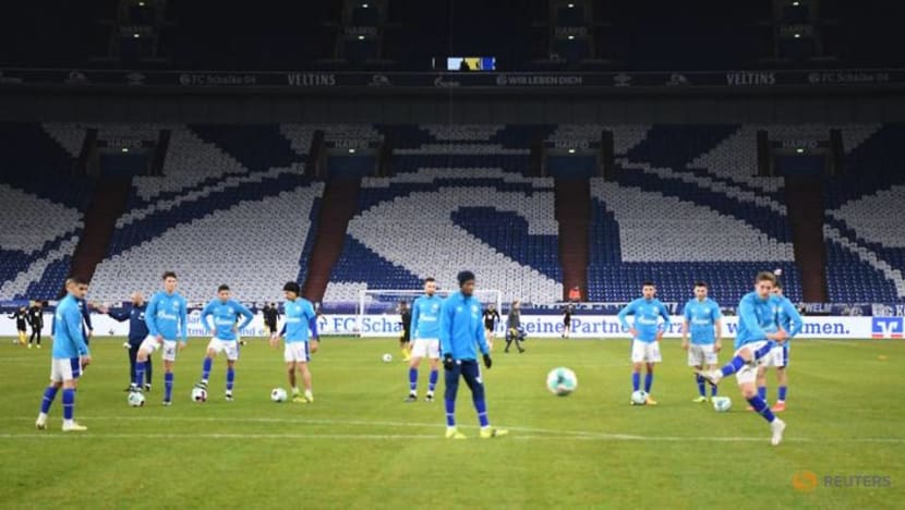 Soccer-Two Schalke players sidelined with coronavirus, Hertha game to proceed