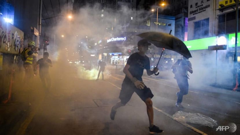 Hong Kong police fire tear gas at protesters outside Prince Edward MTR station