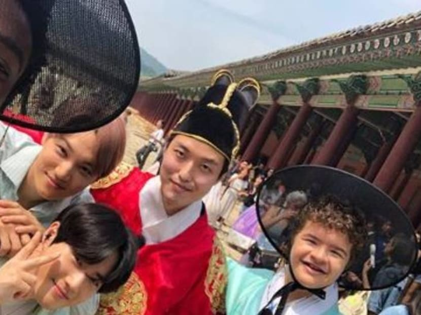Stranger Things and EXO stars hang out in Korea wearing traditional hanbok